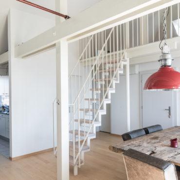 Sanierung und Dachstockausbau Mehrfamilienhaus 1