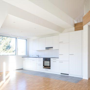 Dachstockausbau und Fassadensanierung Mehrfamilienhaus 4