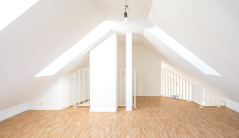 Dachstockausbau und Fassadensanierung Mehrfamilienhaus 10