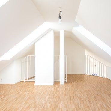 Dachstockausbau und Fassadensanierung Mehrfamilienhaus 7