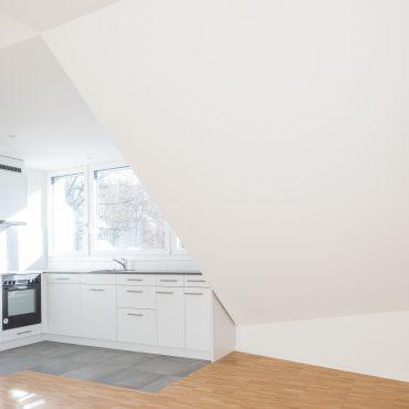 Dachstockausbau und Fassadensanierung Mehrfamilienhaus 6