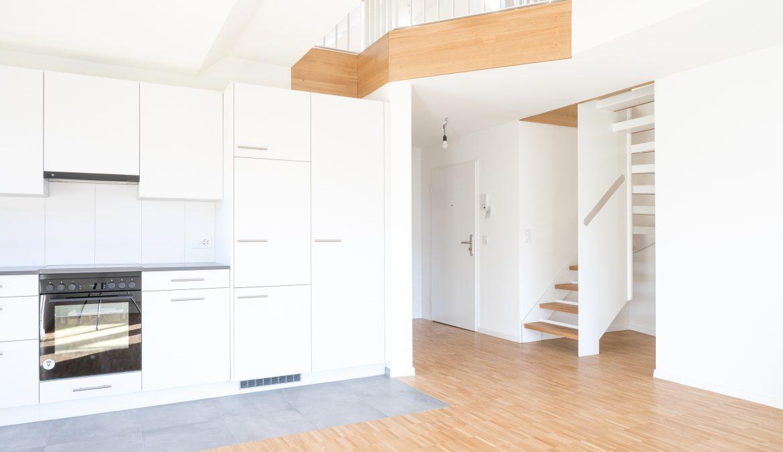 Dachstockausbau und Fassadensanierung Mehrfamilienhaus 13