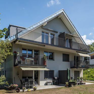 Dachstockausbau und Fassadensanierung Mehrfamilienhaus 1